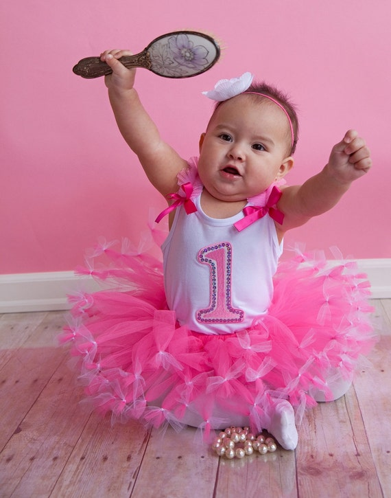 1st year Birthday Outfit includes pink tutu with tied ends and a number one birthday tank