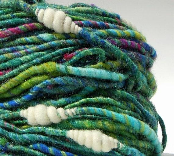 Rapacious- green and teal corespun and white coil handspun yarn