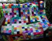 Brilliant batik blocks quilt