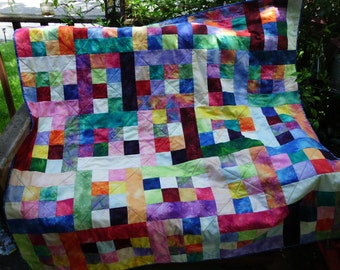 Brilliant batik blocks quilt