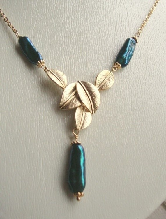 Dark teal keishi pearls necklace with 16Kt gold plated leaf