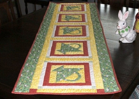 Quilted table runner chicks, ducks and baskets reversible in yellow, greens, pinks and cream