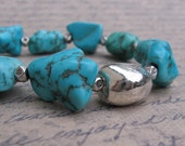 Turquoise & Silver Bracelet - Turquoise Howlite Nuggets, Silver Stone Nugget, and Flower Stamped Cube Spacers - Focus by We Are 1