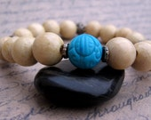 Turquoise & Wood Bracelet - Carved Turquoise Bead and Light Wood Beads with Bali Accent Beads - Imprint by We Are 1