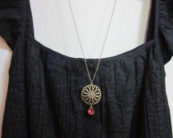 Flower charm with dark rose glass jewel Necklace.