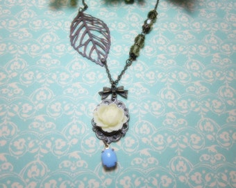 Ivory Rose with Copper Leaf filigree and purplish blue glass jewel.Necklace.  Lovely gift for her.