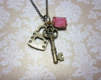 Key and Lock charms with pink glass jewel Necklace.   Lovely gift for her. Birthday, Christmas, Valentine's.