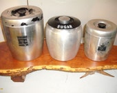 Vintage Kitchen Canister Set in brushed aluminum, chippy paint