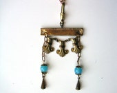 antique balancing necklace of 1920s findings and other vintage parts brass and aqua glass egyptian art deco