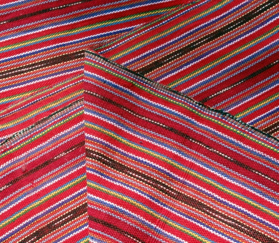 Guatemalan Fabric with Muted Red, yellow, green, and blue stripes