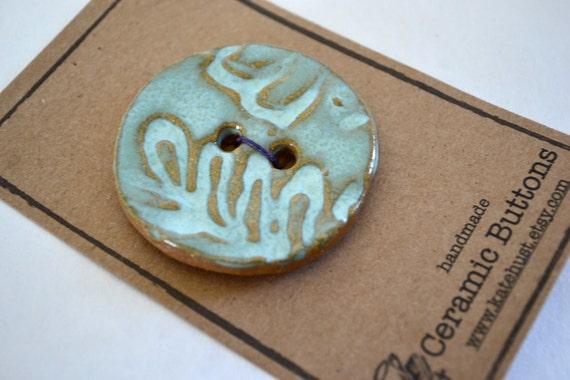 aqua leaf ceramic button - 2 inch circle
