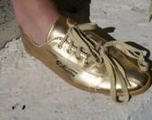L.A. Gear gold sneaker