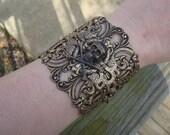 50% off Victorian, gothic, noir antique brass filigree skull cuff bracelet