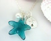 Swarovski blue starfish, silver sand dollar, and pearl charm necklace