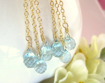 Triple Swiss blue quartz tear drop gold dangle earrings, swiss blue quartz gold tassle earrings, Frozen raindrop snow cluster earrings