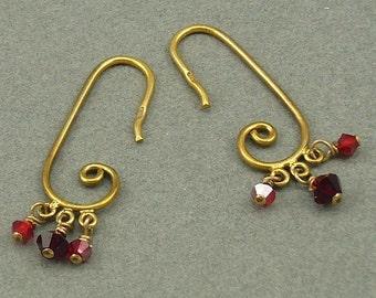 Ruby-red Curls gold earrings