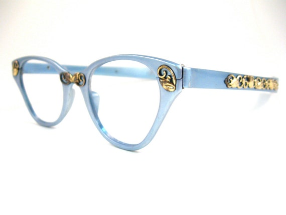 TURA sky blue cat eye glasses. gold embellishments. ornate. 1950s retro eyewear. aluminum and gold. no lenses. (VFAC)