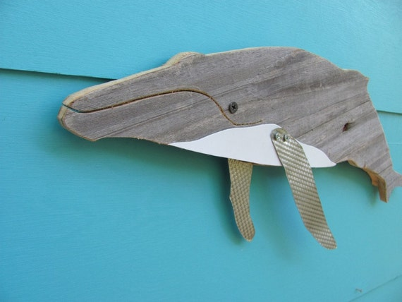 Humpback whale made of recycled wood.