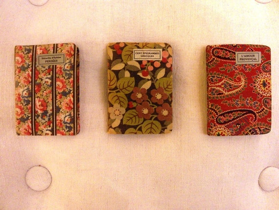RESERVED FOR VICTORIA Groupe of three antique miniature french booklets covered with fabric