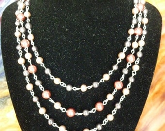 three strand pearl necklace and bracelet