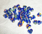 6x6mm flat cobalt blue heart with multicolored flowers, sold in bags of  25pcs