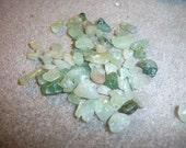green aventurine (natural), 5-10mm chip. Sold per 15-inch strand