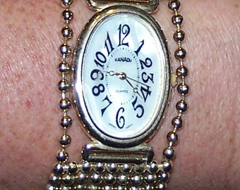 Blast From the Past 1980s Xanadu Oval Mother of Pearl Face Watch