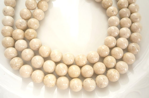 10mm River stone, creamy white  round beads, full strand