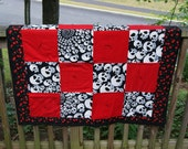 Baby Quilt with cherries and infinity skull fabric