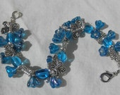 Charm turquoise bracelet with butterfly beads and flower charms