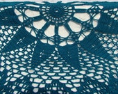 Teal starburst queen-sized circular crocheted afghan