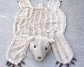 RESERVED FOR LOVEABOUNDSHERE Payment 1 teddy bear rug constructed out of  vintage faux fur coat 53 in x 27 in