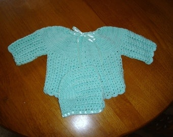 mint green baby sweater and bonnet