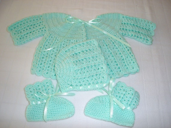 hand crocheted mint green sweater cap and booties