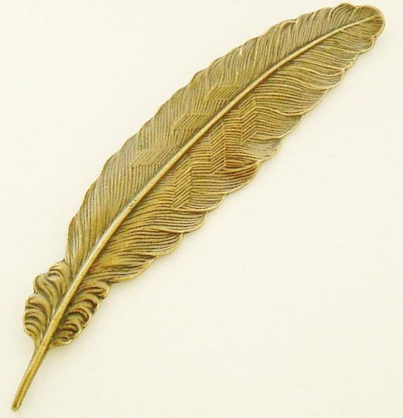 Vintage bronze huge feather brooch.