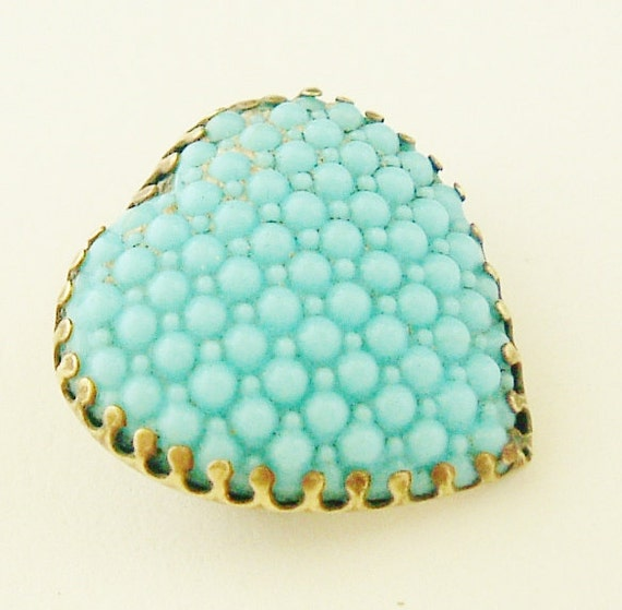 Art deco embossed turquoise glass heart brooch in aged brass