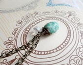 Wire wrapped jade green speckled stone necklace with glass bead accent, Dappled