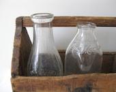 Two Antique Milk Bottles
