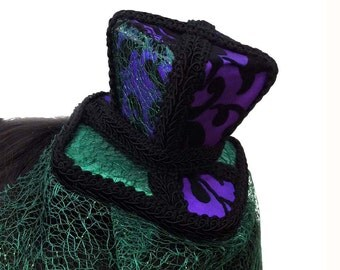 Top Hat in Iridescent Green and Purple Brocade with Cobweb Veil Reduced from Thirty Five