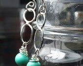 Sterling Silver  Earrings .  Hand Wrought  .  Wire Wrapped .  Turquoise .  Dangle