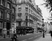 Man on a bike, Rue du Cloitre Notre Dame, Paris France