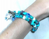 Turquoise Memory Wire coral bracelet with starfish charms