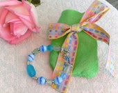 Children's Bracelet, blue with Easter Egg and frosted beads