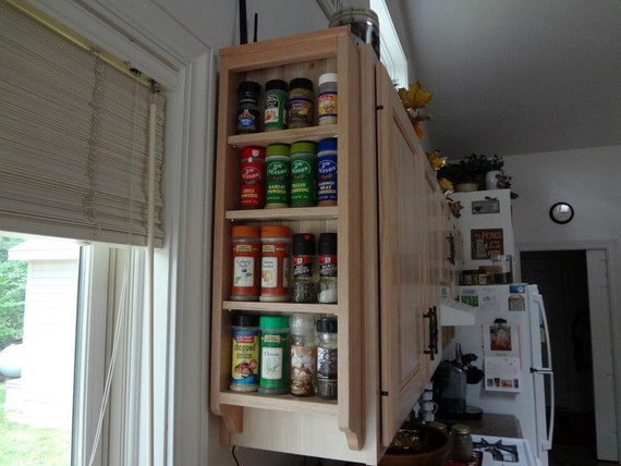 Wall mounted solid wood spice rack.