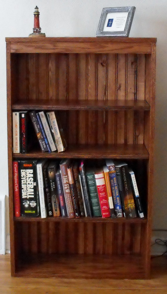 Book Case, Oak Wood with bead board back and adjustable shelves.