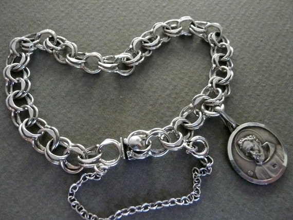 RESERVED for HEATHER - Silver St. Francis Charm Bracelet