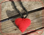 Crocheted heart on string of wooden beads necklace