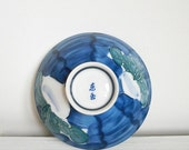 Japanese blue, white and green lustre porcelain bowl, hand-painted and tube lining