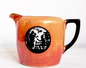 Intriguing Art Deco jug, iridescent orange and black creamer with silhouettes, lustreware, from Czechoslovakia