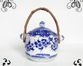 Vintage Chinese pot, blue and white prunus flowers, rattan handle and porcelain
